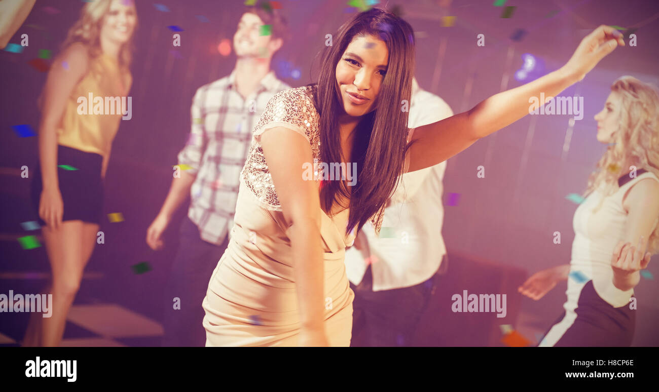 Composite image of friends dancing cheerfully - Stock Image
