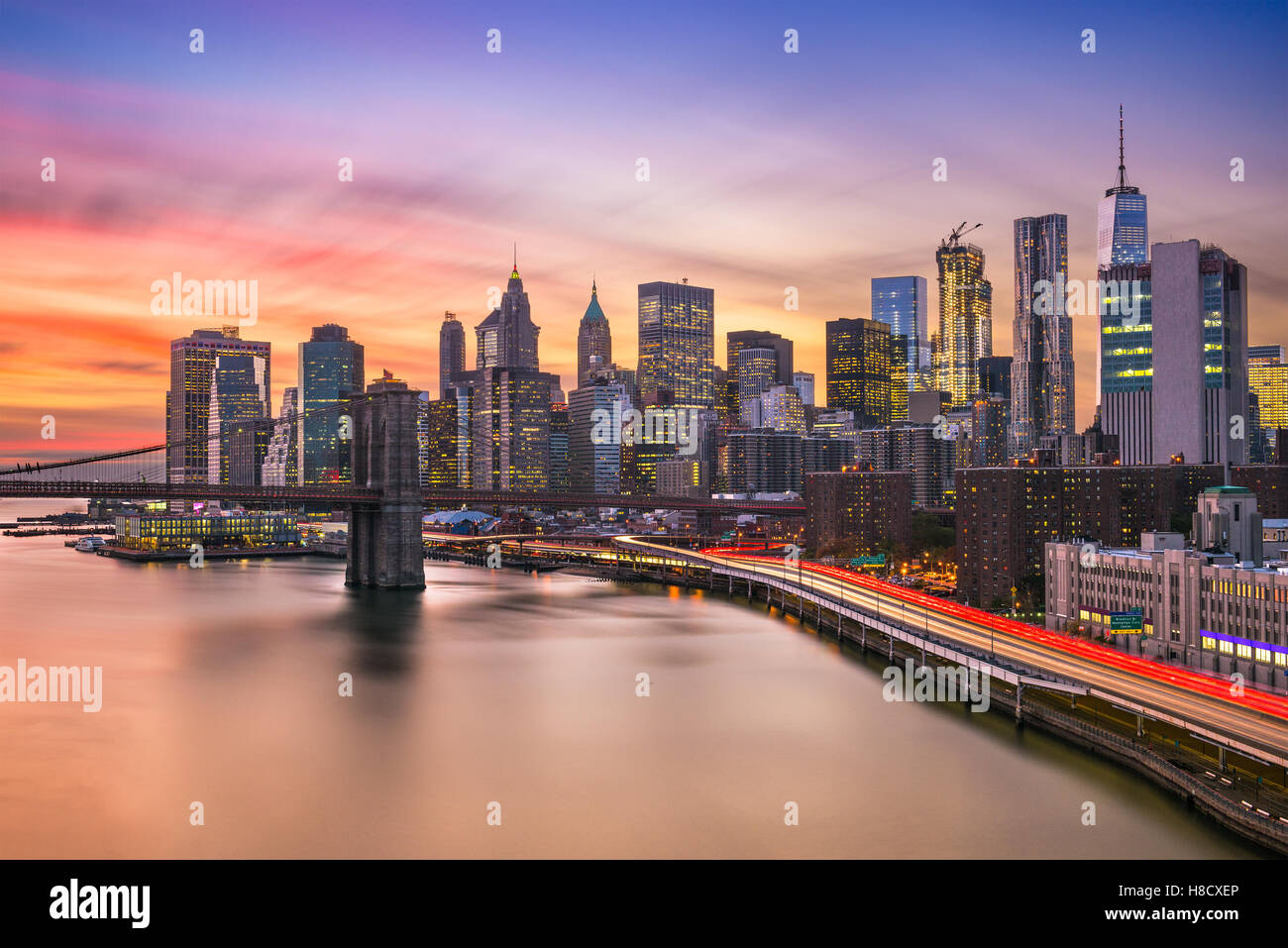 New York City financial district skyline at sunset over the East River. - Stock Image