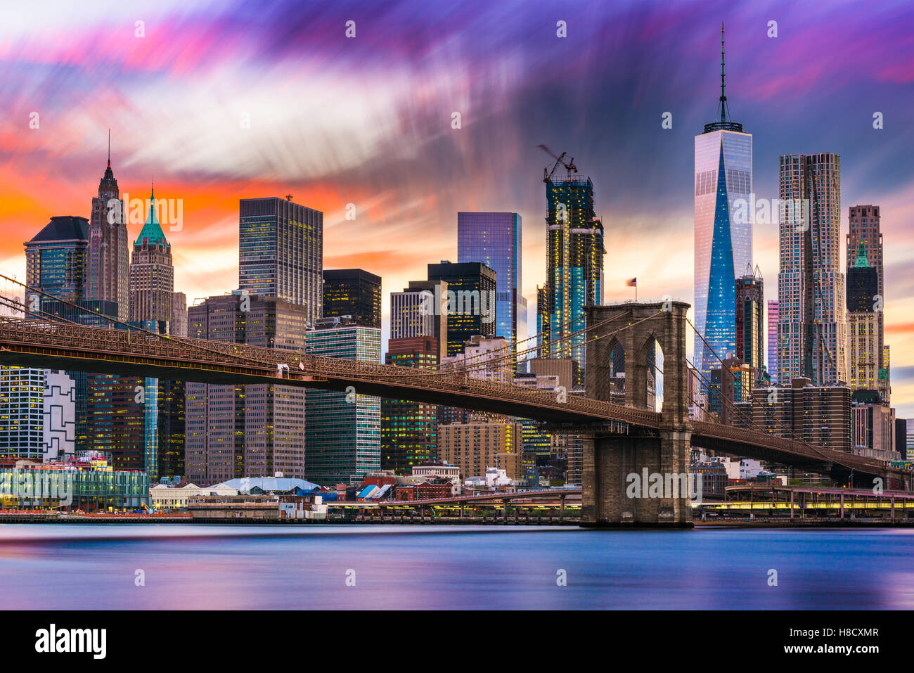 New York City skyline with the Brooklyn Bridge and Financial district on the East River. - Stock Image