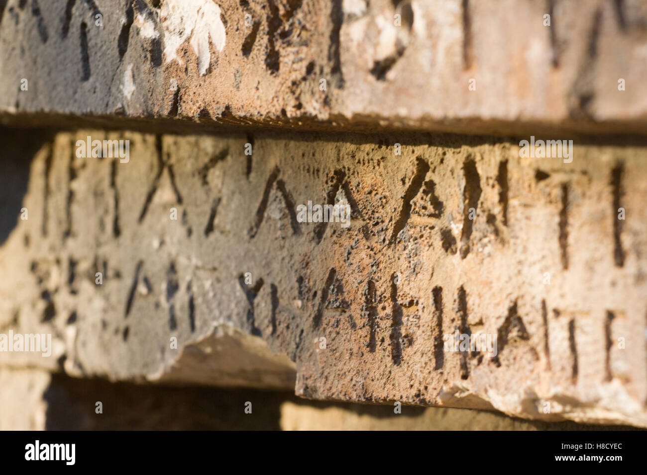 Inscription on old tomb in the Greek language. Characters, symbols. Hieroglyphs - Stock Image