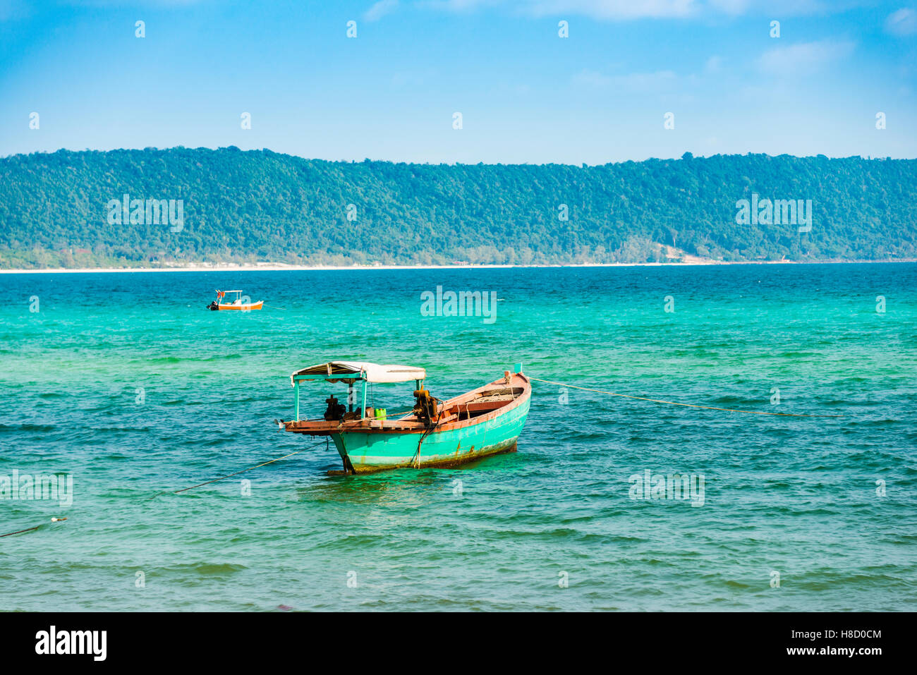 Traditional long-tail boat in turquoise sea, Long Beach, Sok San Village, Koh Rong Island, Krong Preah Sihanouk, Stock Photo