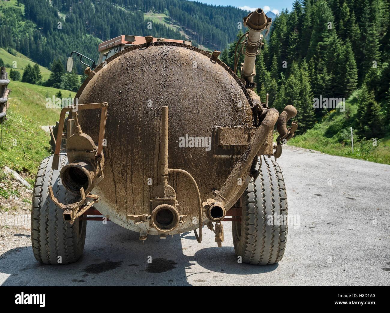 Dirty tank of liquid manure spreader - Stock Image