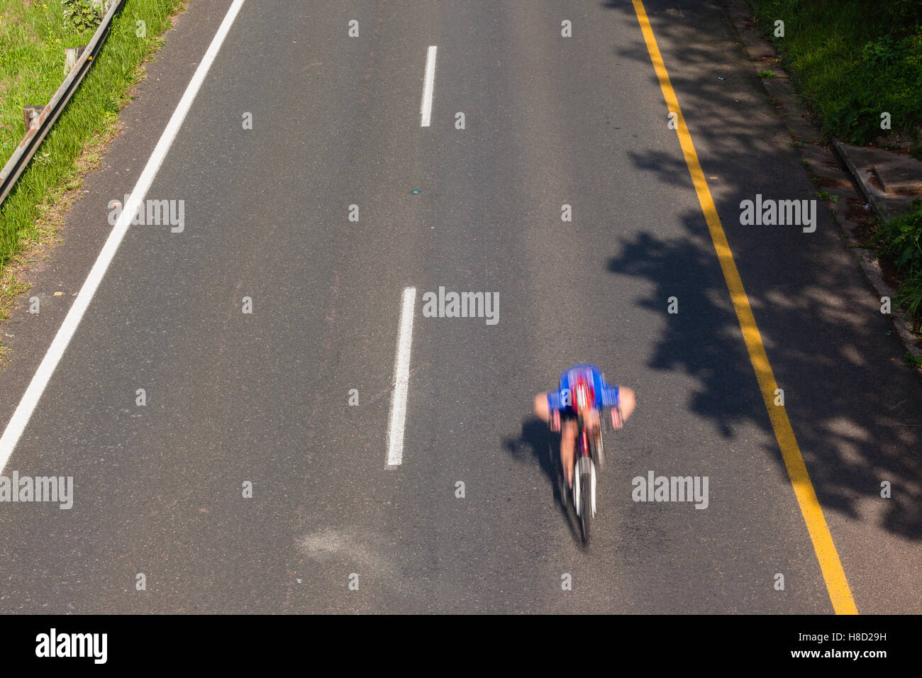 Cycling cyclists racing speed blur overhead photo action on road Stock Photo