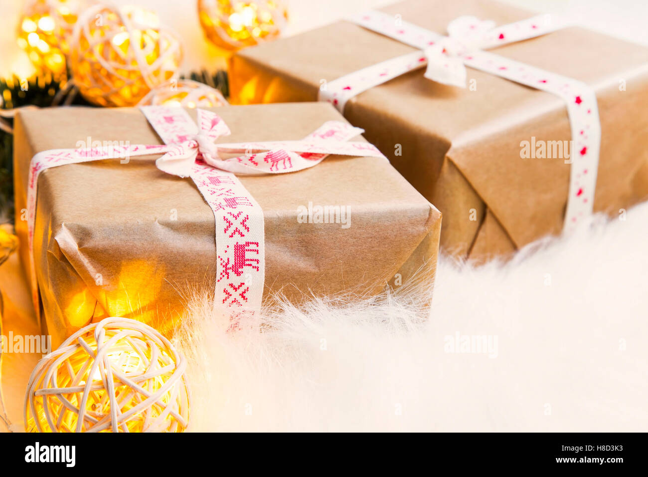 Vintage festive rustic Christmas gifts with ribbons and decoration ...