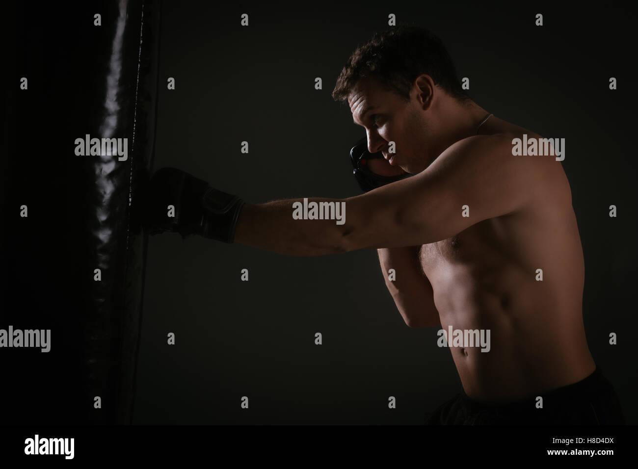 Training On A Punching Bag - Stock Image