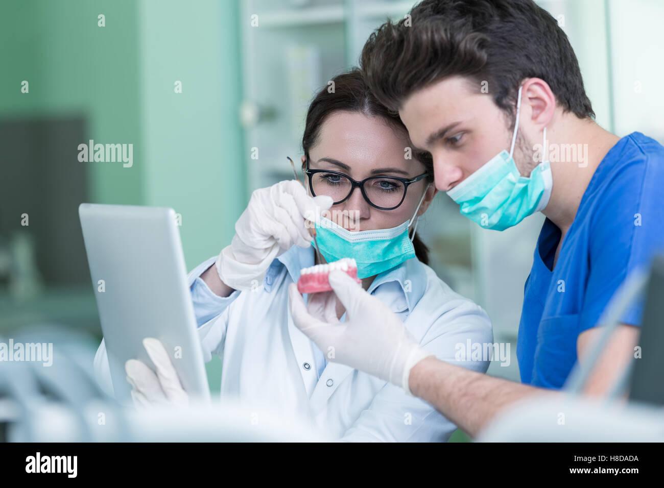 Students with dental prosthesis, dentures, prosthetics work. - Stock Image