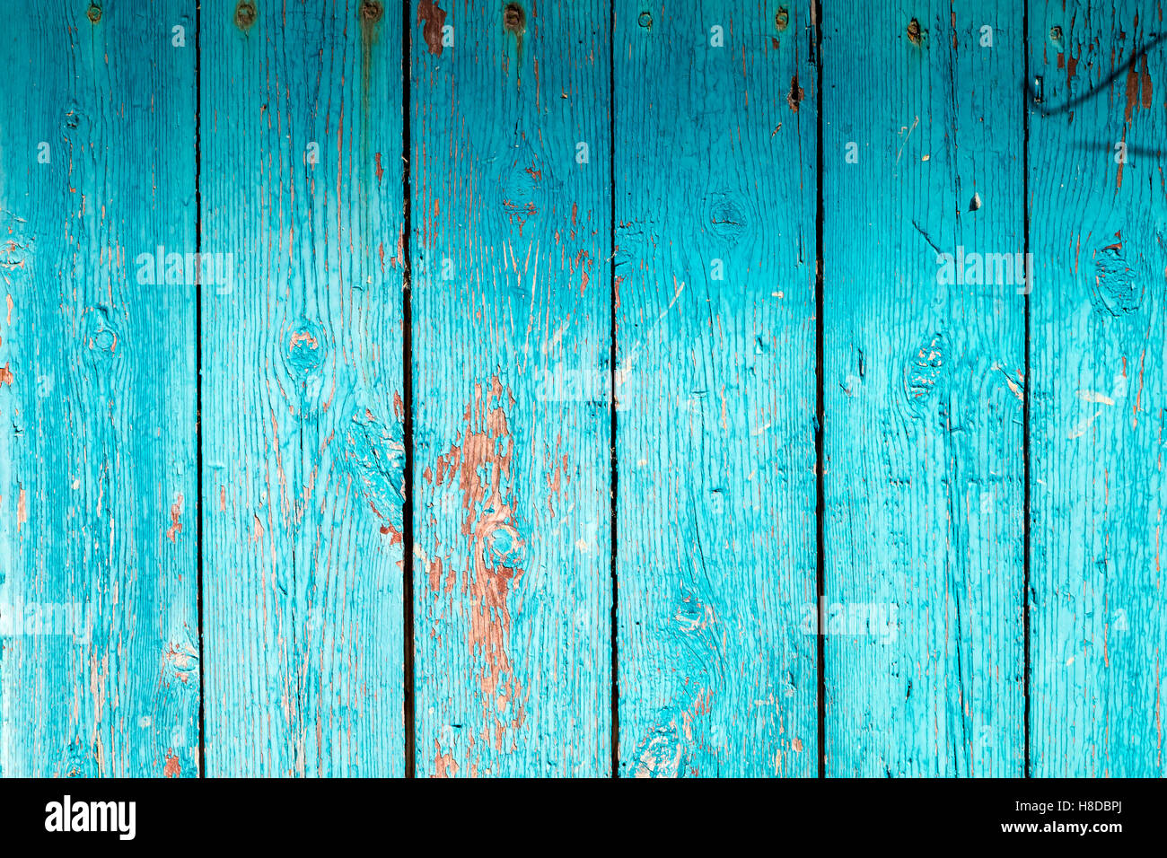 background vertical wooden planks with vintage turquoise paint - Stock Image