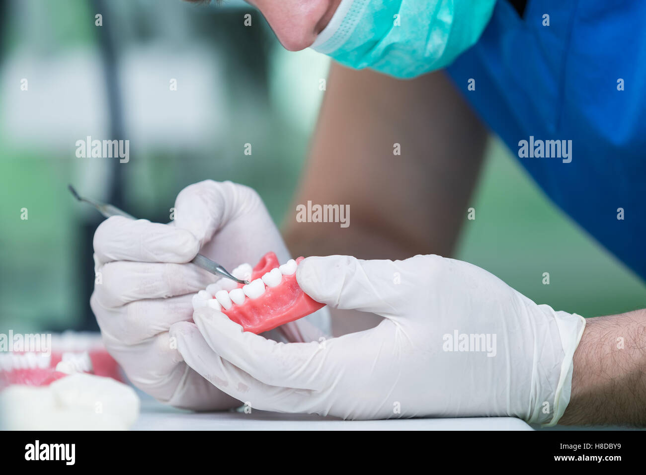 Prosthetics hands while working on the denture. - Stock Image