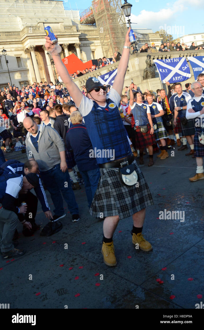 London, UK. 11th Nov, 2016. Scottish football fans gather in Trafalgar Square ahead of the the Scotland V England Stock Photo