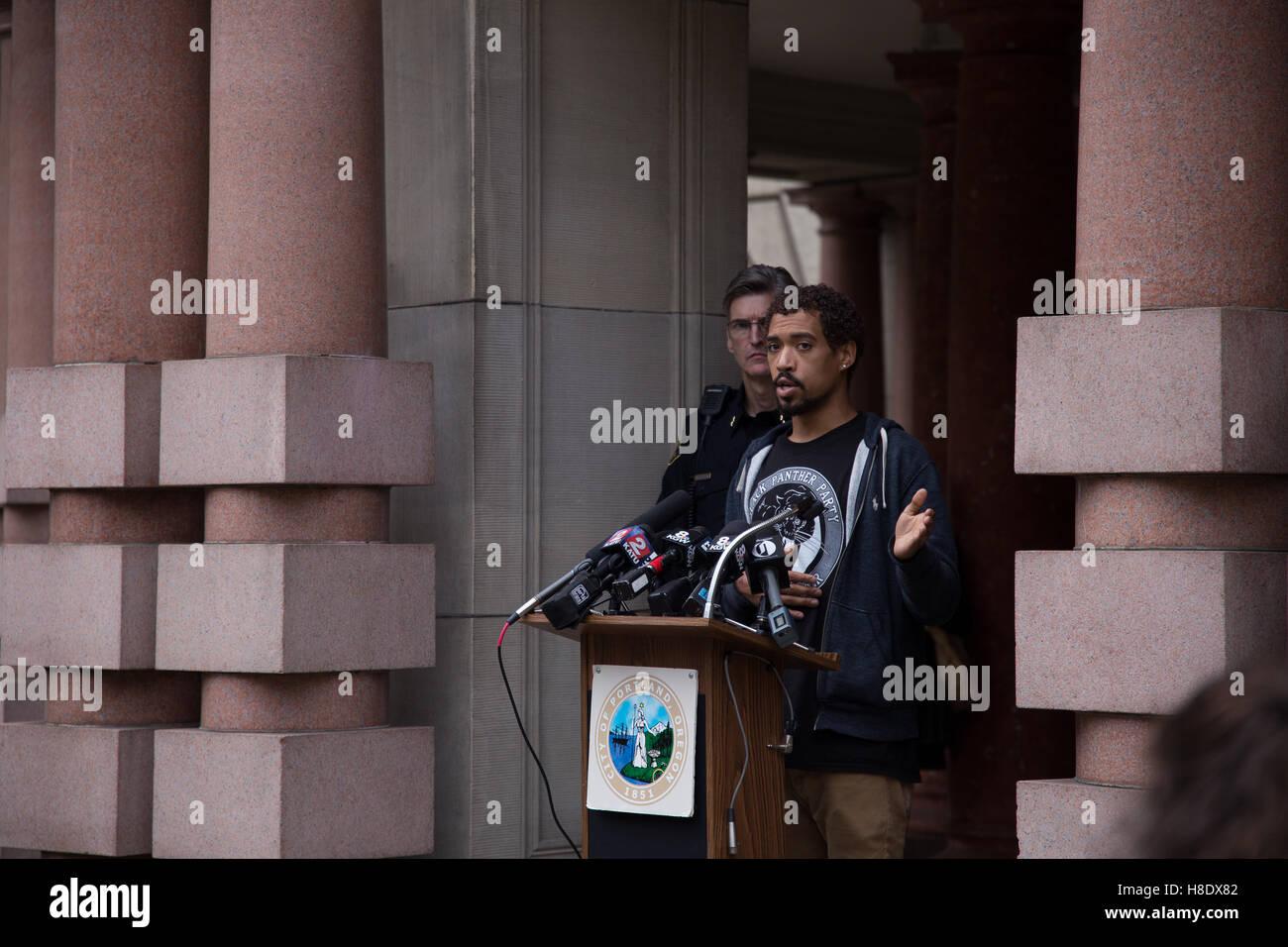 Portland, USA. 11th November, 2016. Portland Oregon 'Not My President' protest organizer speaks during a - Stock Image