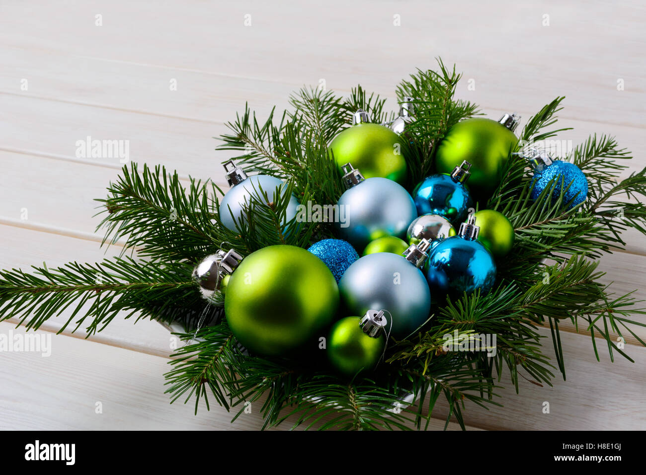 Christmas Table Centerpiece With Silver Blue And Green Ornaments