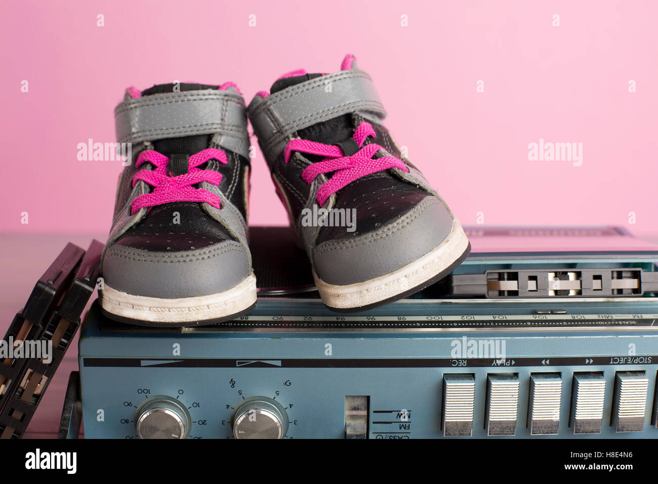 portrait in 80's style of a little child sneakers shoes - Stock Image
