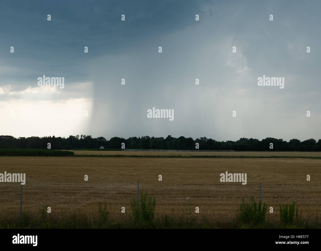 Distant rainstorm in the countryside - Stock Image