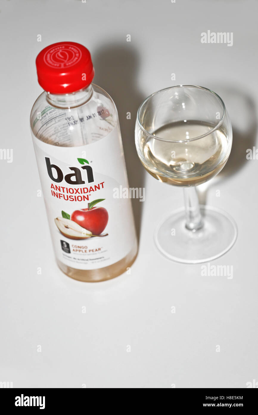 Bottle of Bai brand antioxidant infusion juice drink and glass - Stock Image