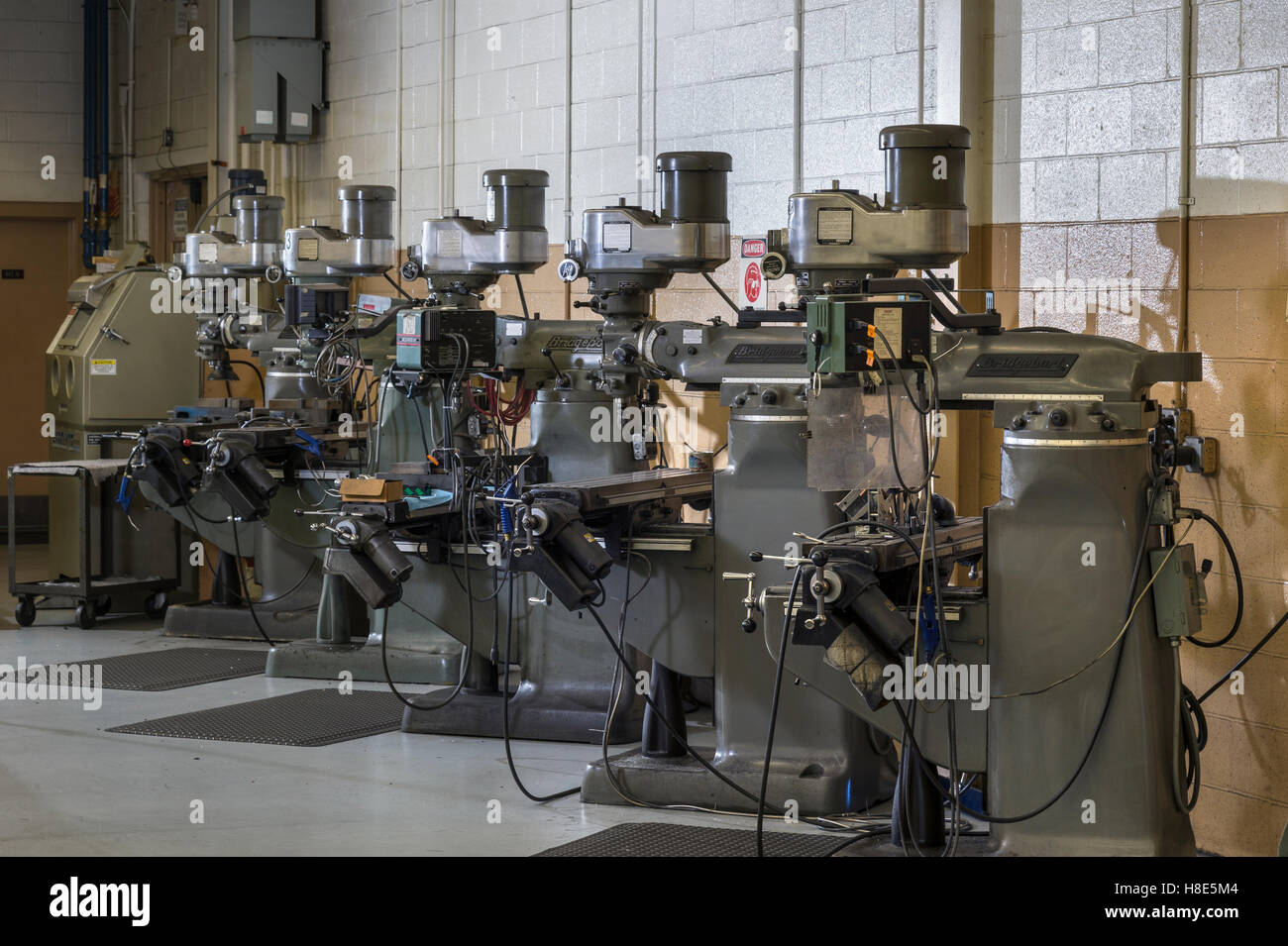 Row Of Industrial Drill Presses In Machine Shop - Stock Image