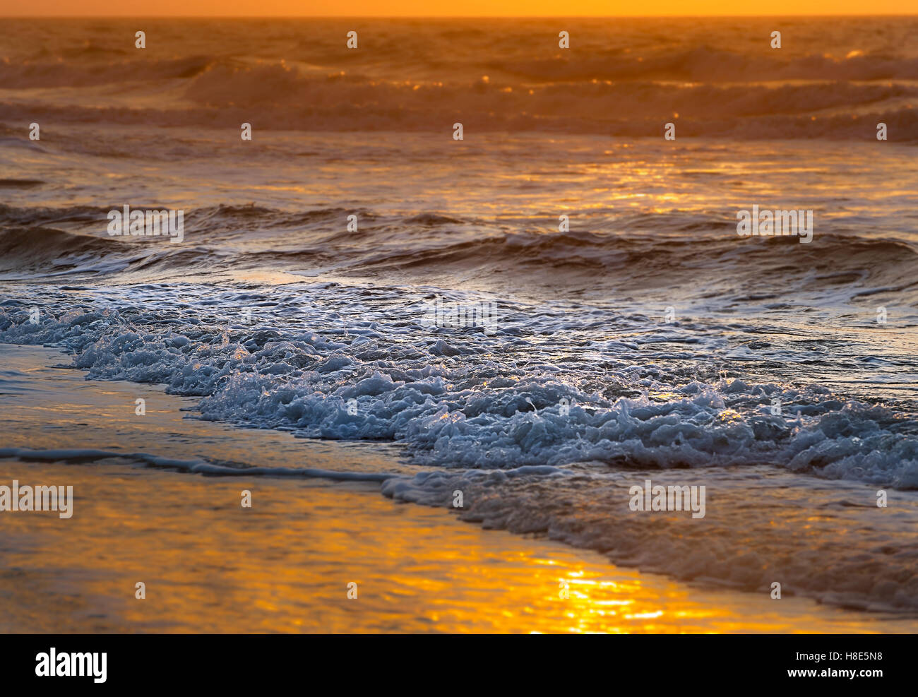 Artistic Sunrise With Waves - Stock Image