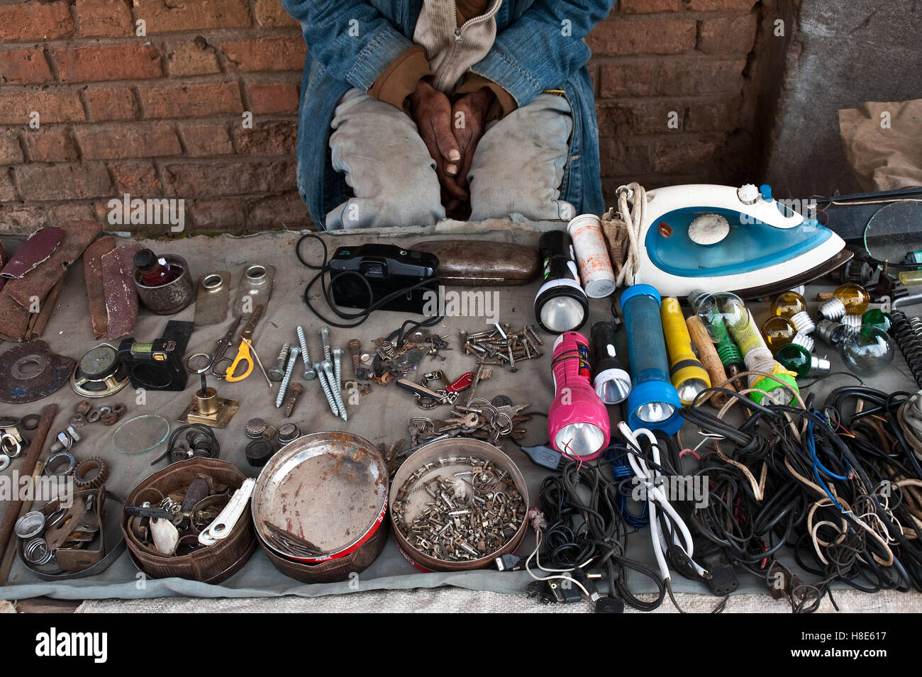 Man selling scrap and second hand goods ( Madagascar) - Stock Image