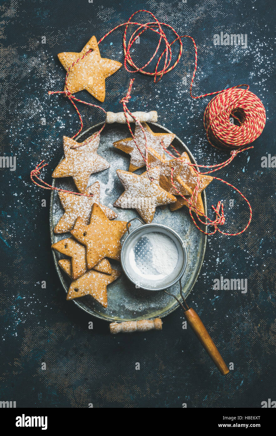 Christmas holiday star shaped gingerbread cookies for Christmas tree decoration, sieve, decorative snowflakes, balls - Stock Image