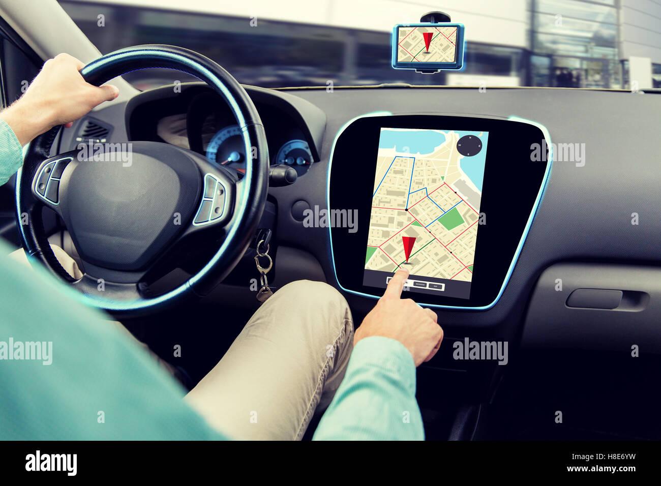 close up of man driving car and using navigator - Stock Image