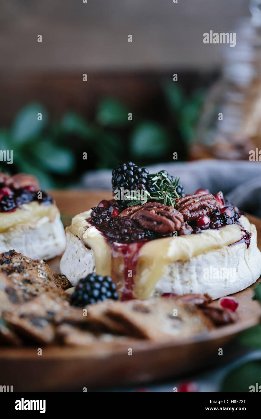 Baked Brie with Blackberry Compote and Spicy Candied Pecans - Stock Image