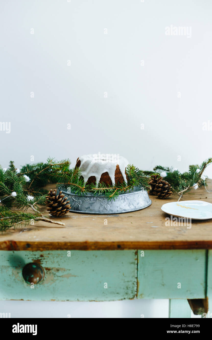 Wintery cake on a blue wooden table - Stock Image