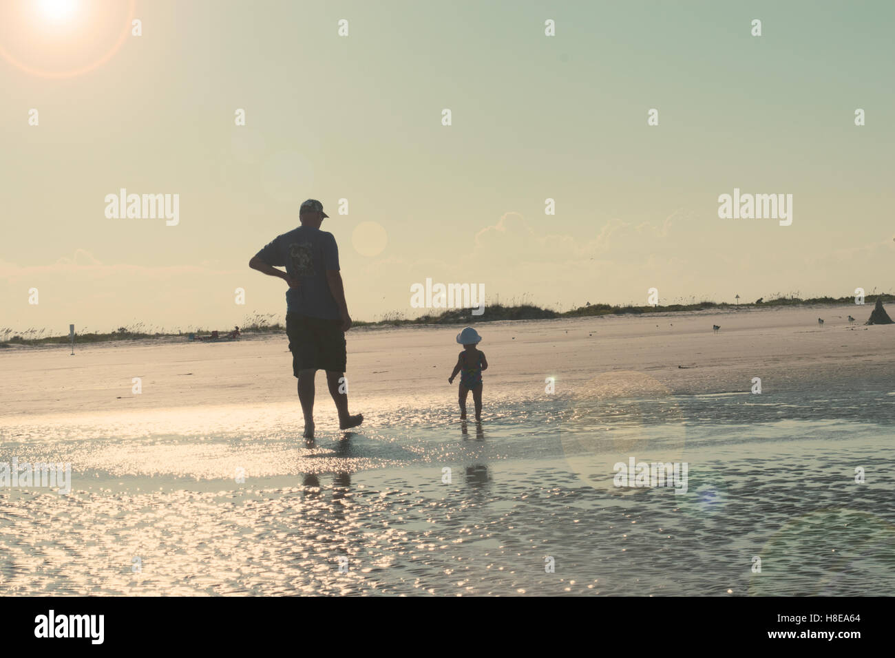 Dad and baby on beach - Stock Image