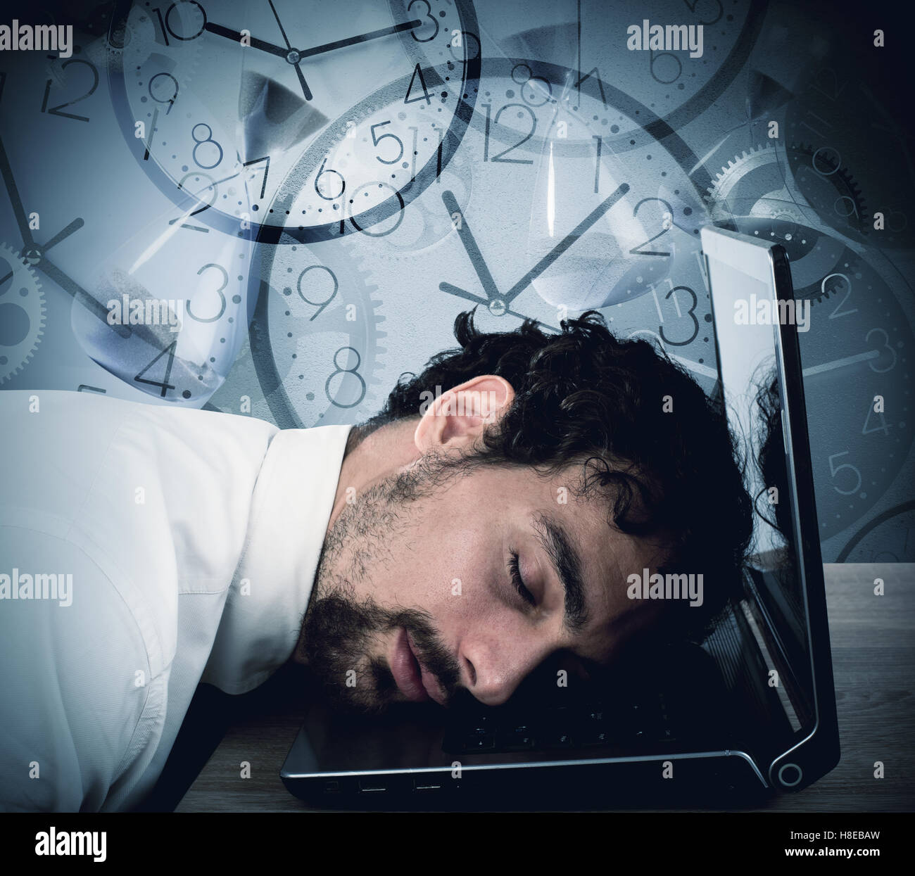 Businessman tired from overwork - Stock Image