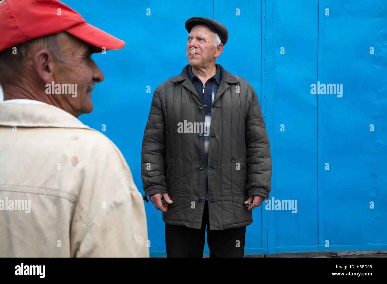 Kyrgyzstan - Men living in Tamga village  -  Travel people Central Asia - Stock Image