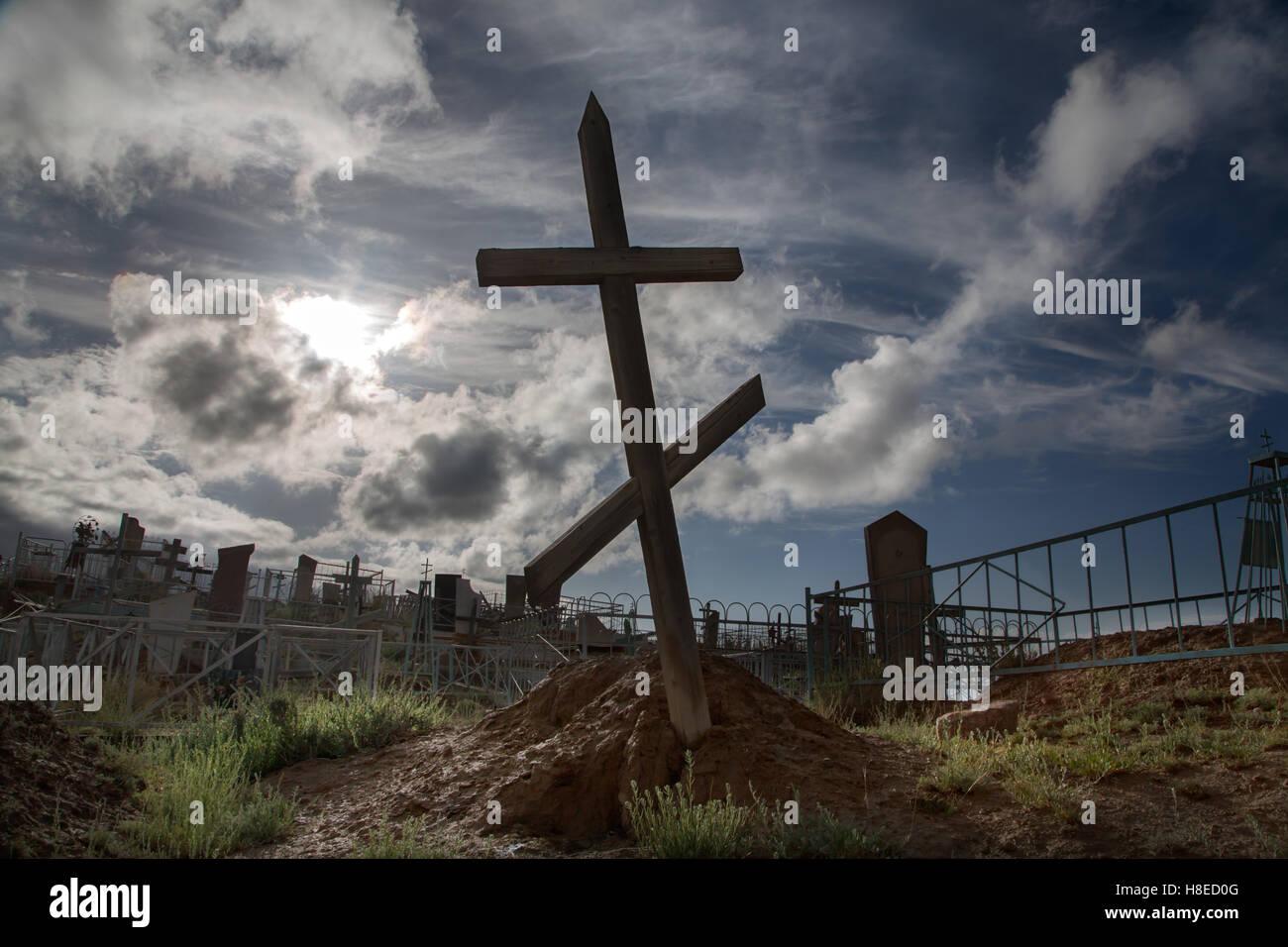 Kyrgyzstan -  cross backlight in a Christian cemetery near Tamga  village - Stock Image
