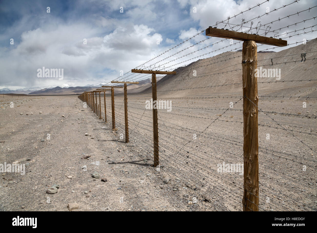 Security fence - no access- at the border between Tajikistan and China - GBAO province - Stock Image