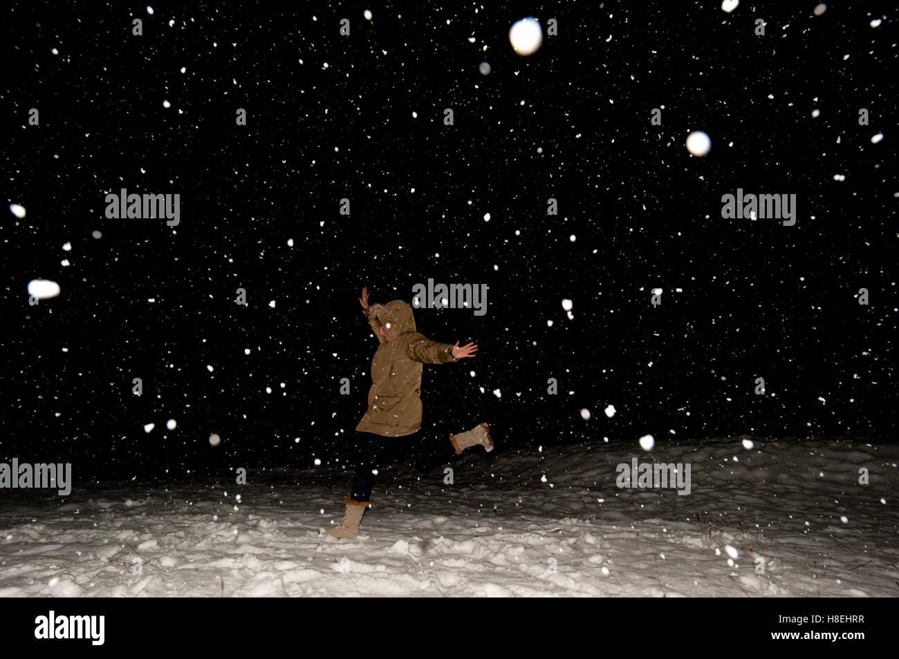 Snowfall at night lit up by a flashgun, Falcade, The Dolomites, Italy, Europe - Stock Image