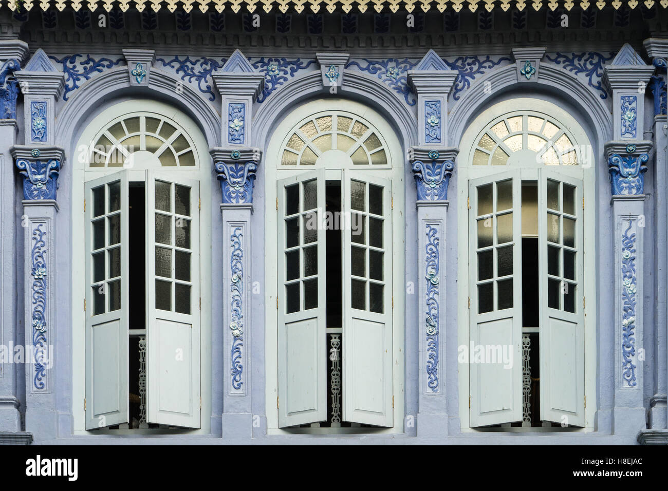 Traditional shophouse windows open out onto a street in the Orchard Road neighborhood in Singapore, Southeast Asia, - Stock Image