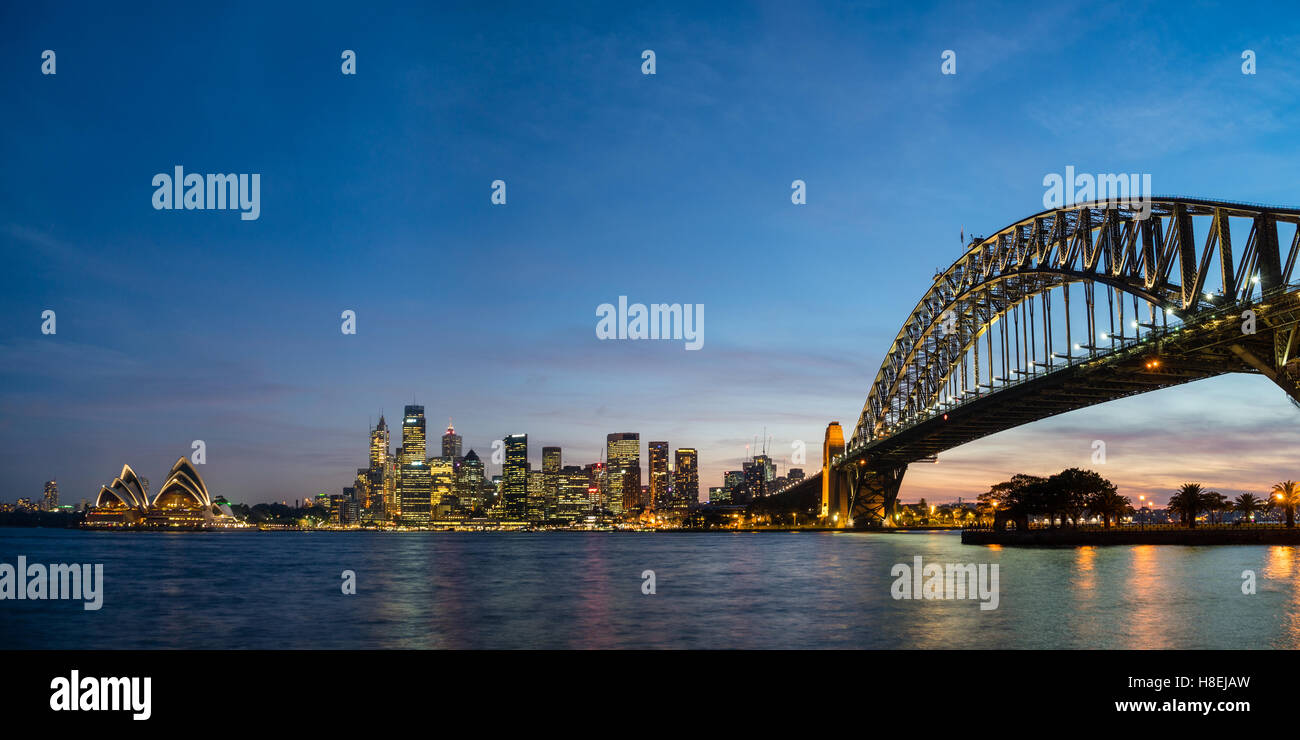 Sydney's iconic buildings lit up as dusk settles over the city, Sydney, New South Wales, Australia, Pacific - Stock Image
