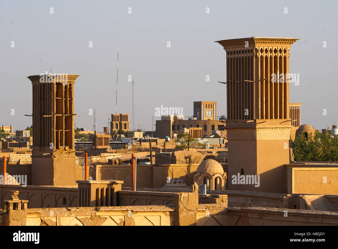 Cityscape at dusk with many windtowers (badgirs), Yazd, Iran, Middle East - Stock Image