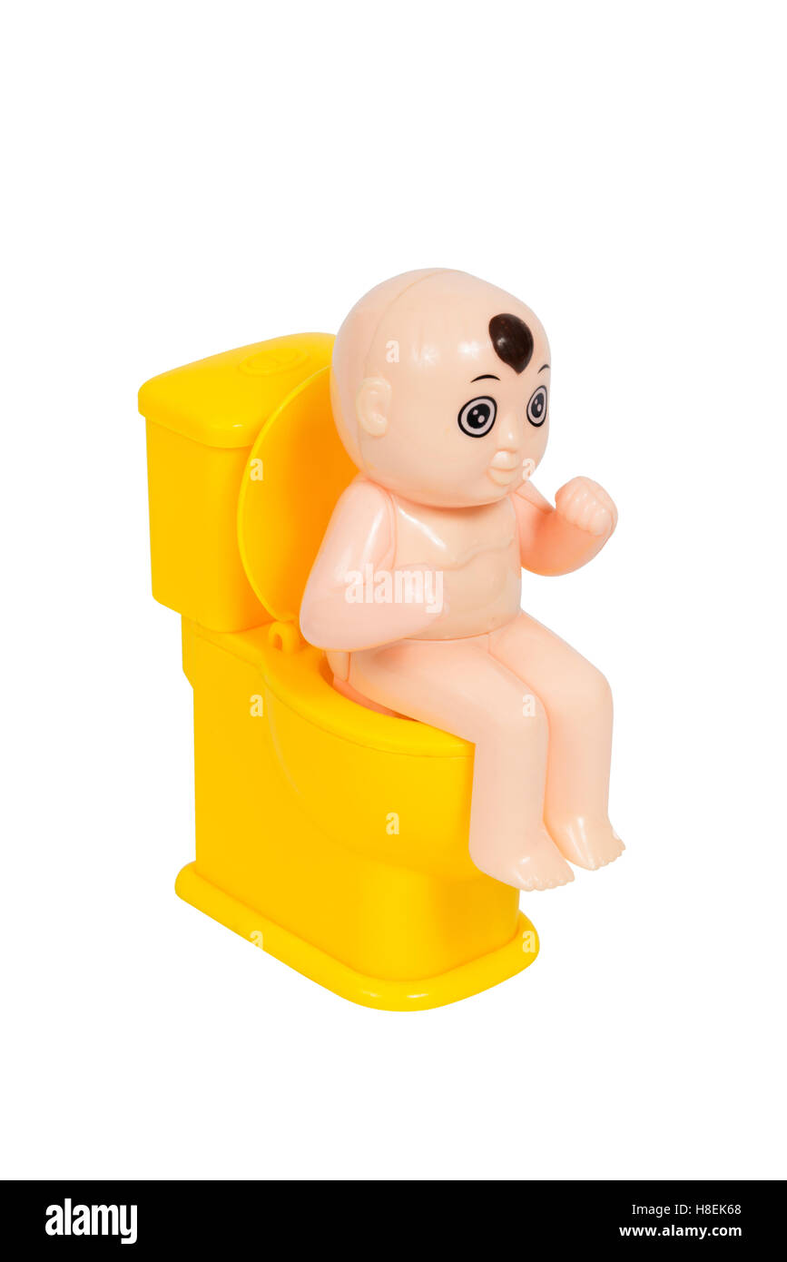 Doll Baby Toy Sit On Yellow Toilet Bowl Isolated White Background