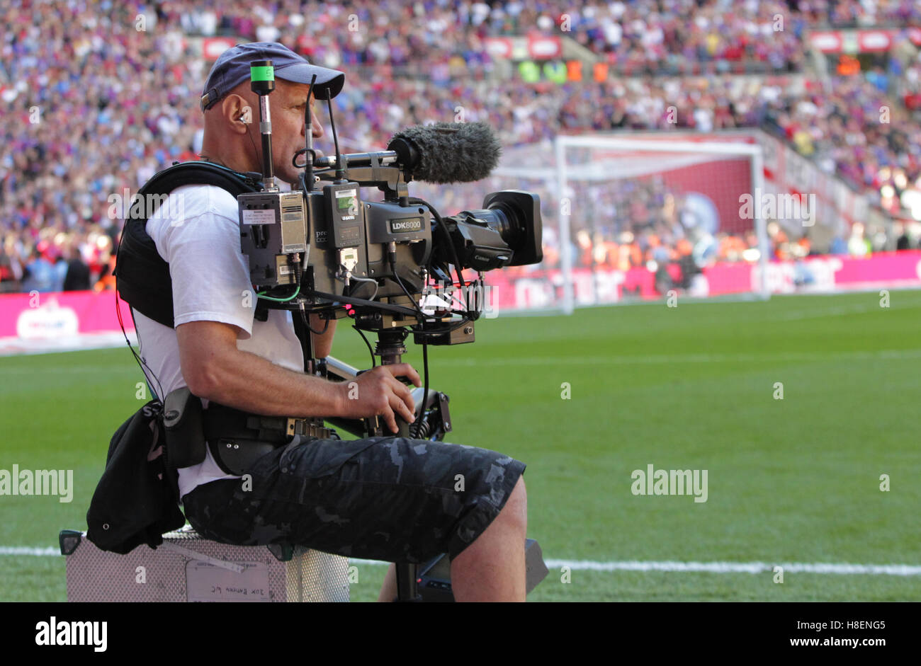Television Cameraman with a Steadicam system at a football match Stock Photo