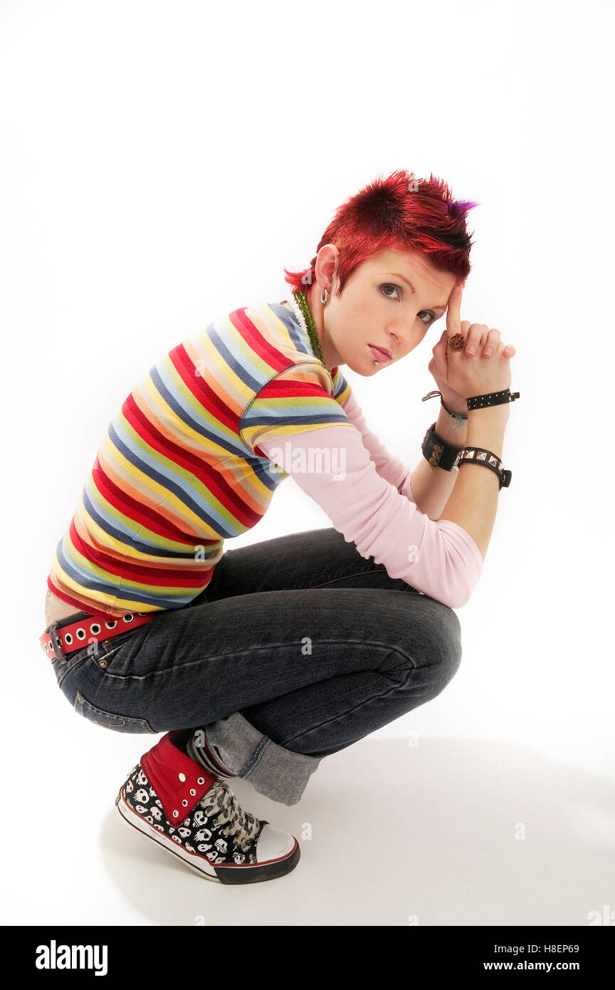 Portrait of female with Red Faux hawk Stock Photo: 125714577