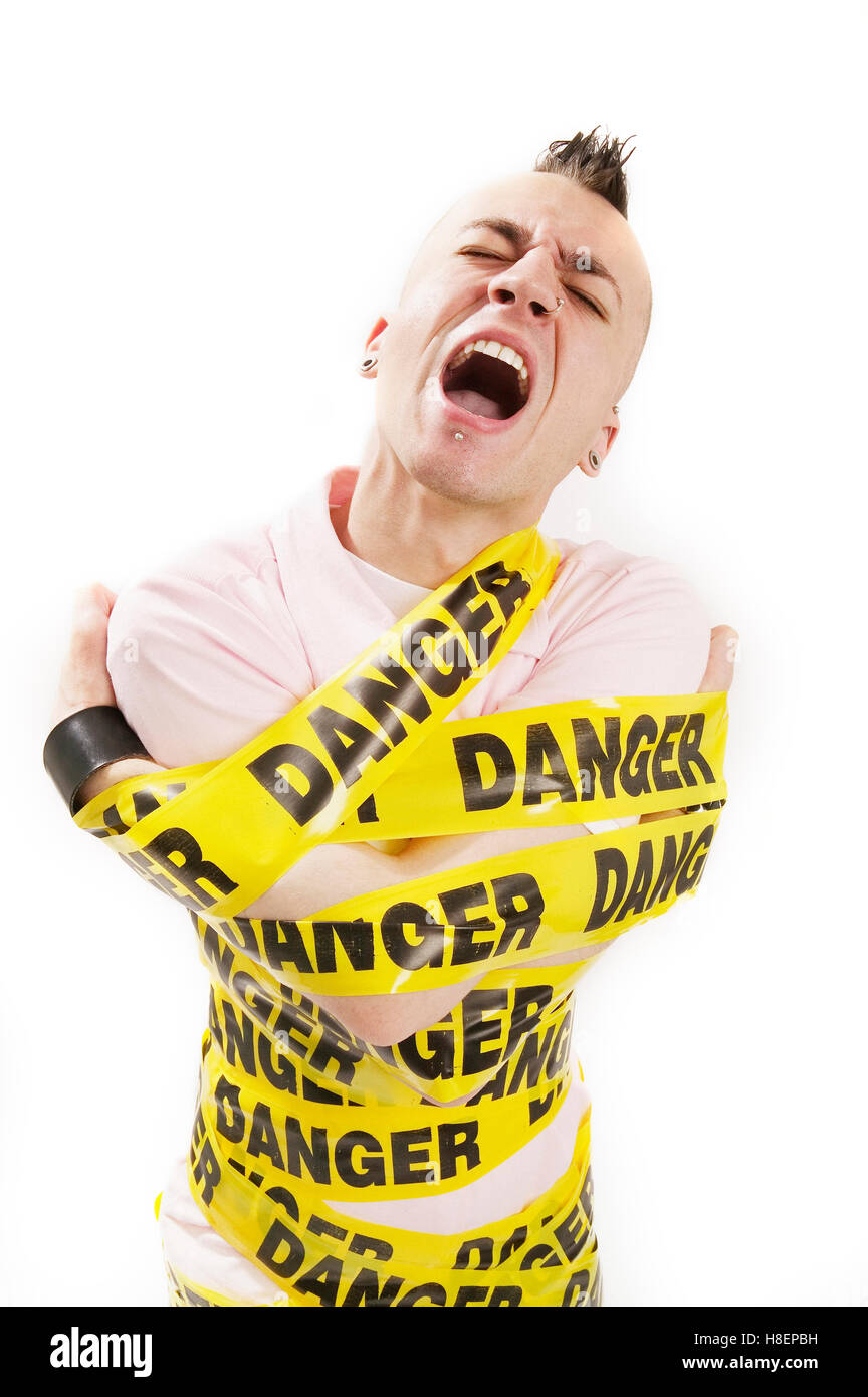 man wrapped up with danger tape - Stock Image