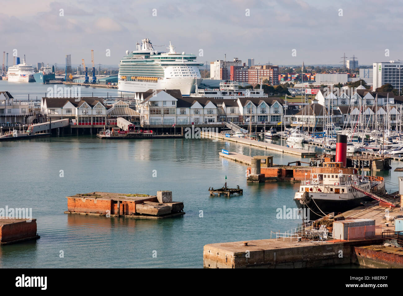 Veteran tug boat Calshot and Navigator of the Seas moored in Southampton, u.k. - Stock Image