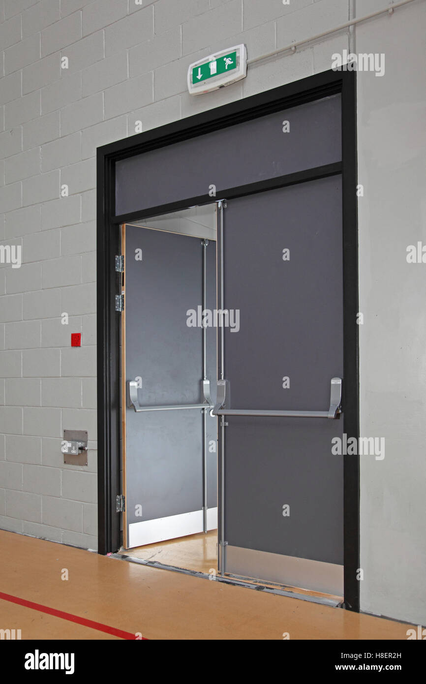 Fire escape door in the sports hall of a modern London school. Shows push-bar and panic bolt system & Fire escape door in the sports hall of a modern London school ...