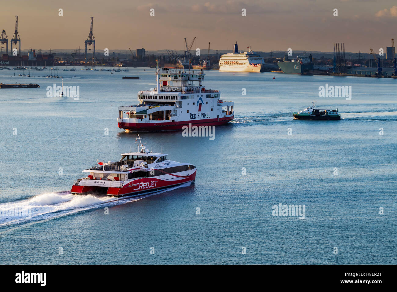 RedJet arriving and Red Funnel Ferries leaving Southampton, u.k. Stock Photo