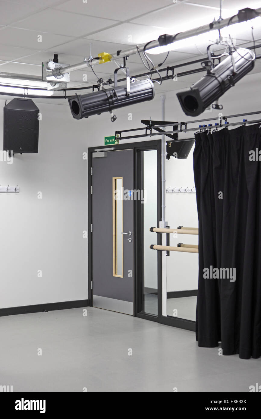 Drama and dance studio in a new London secondary school. Shows spotlights, sound system, wall mirror and dance rails - Stock Image