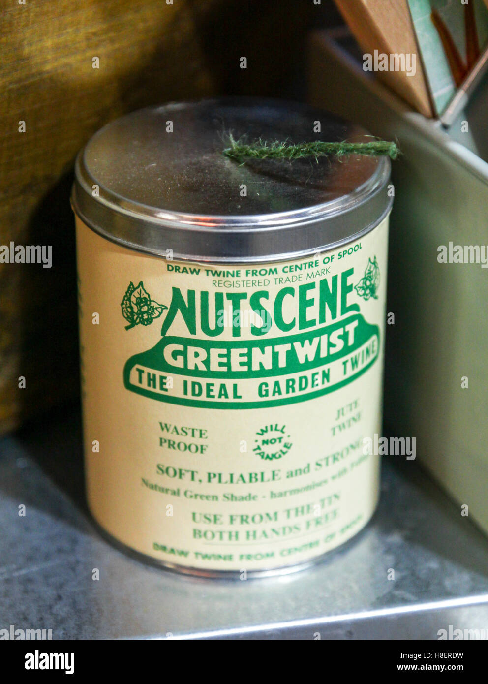 A tin of 'Nutscene' green twist garden twine - Stock Image