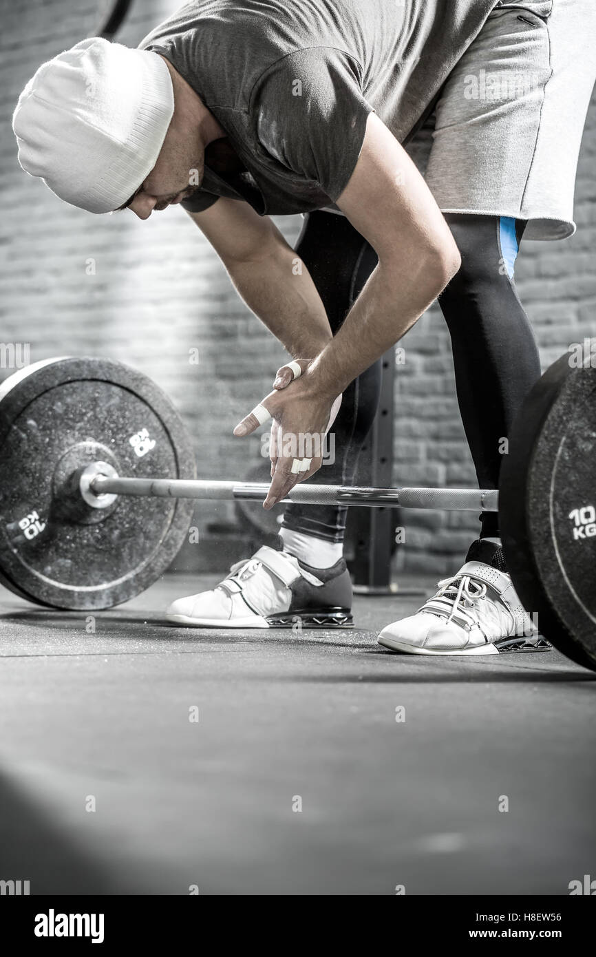 Man's crossfit workout with barbell - Stock Image