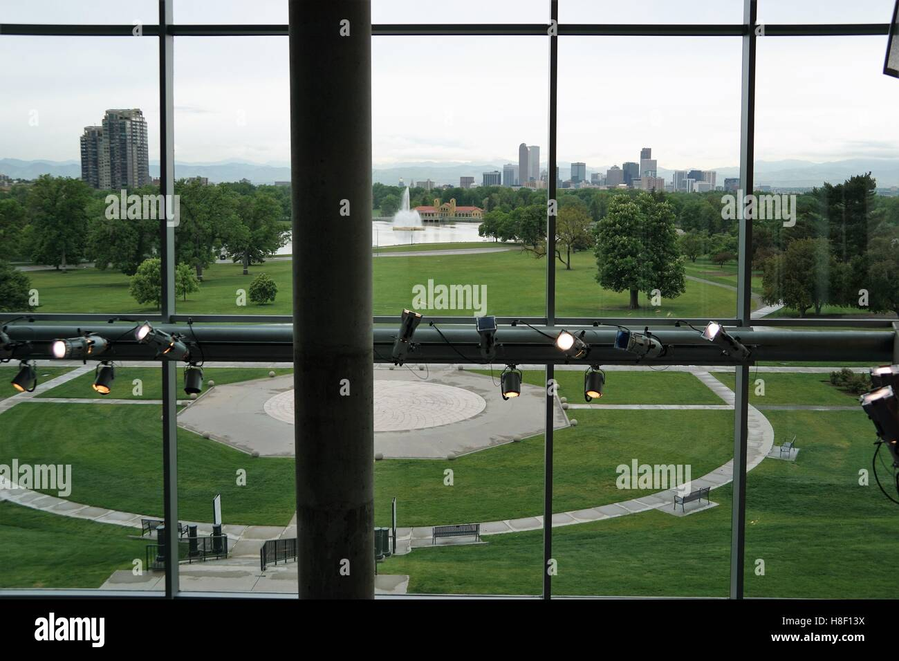 Skyline view from Denver Museum of Natural History with lights in the foreground - Stock Image