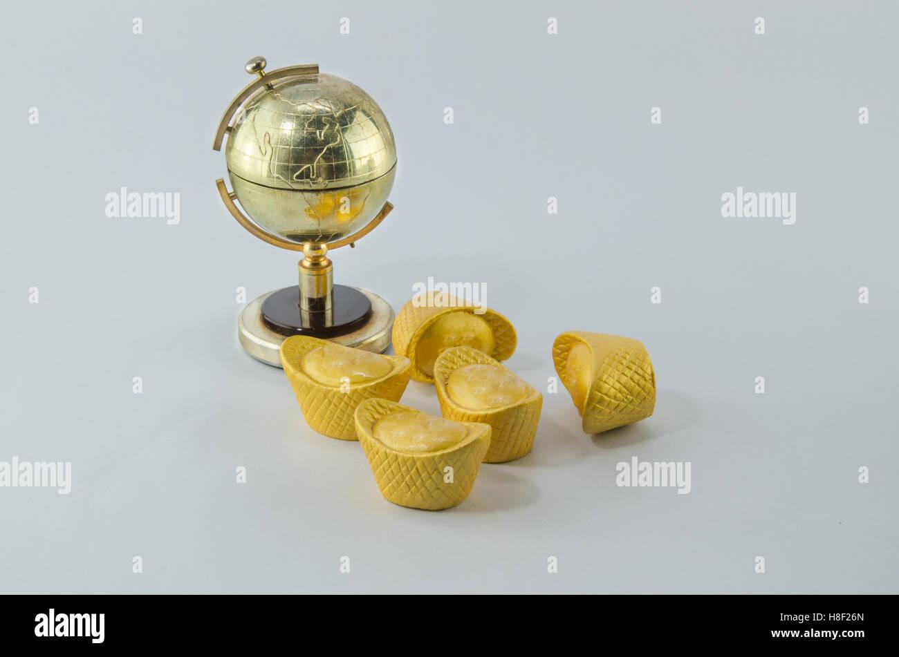 Globe golden Gold ingot Chinese White background - Stock Image