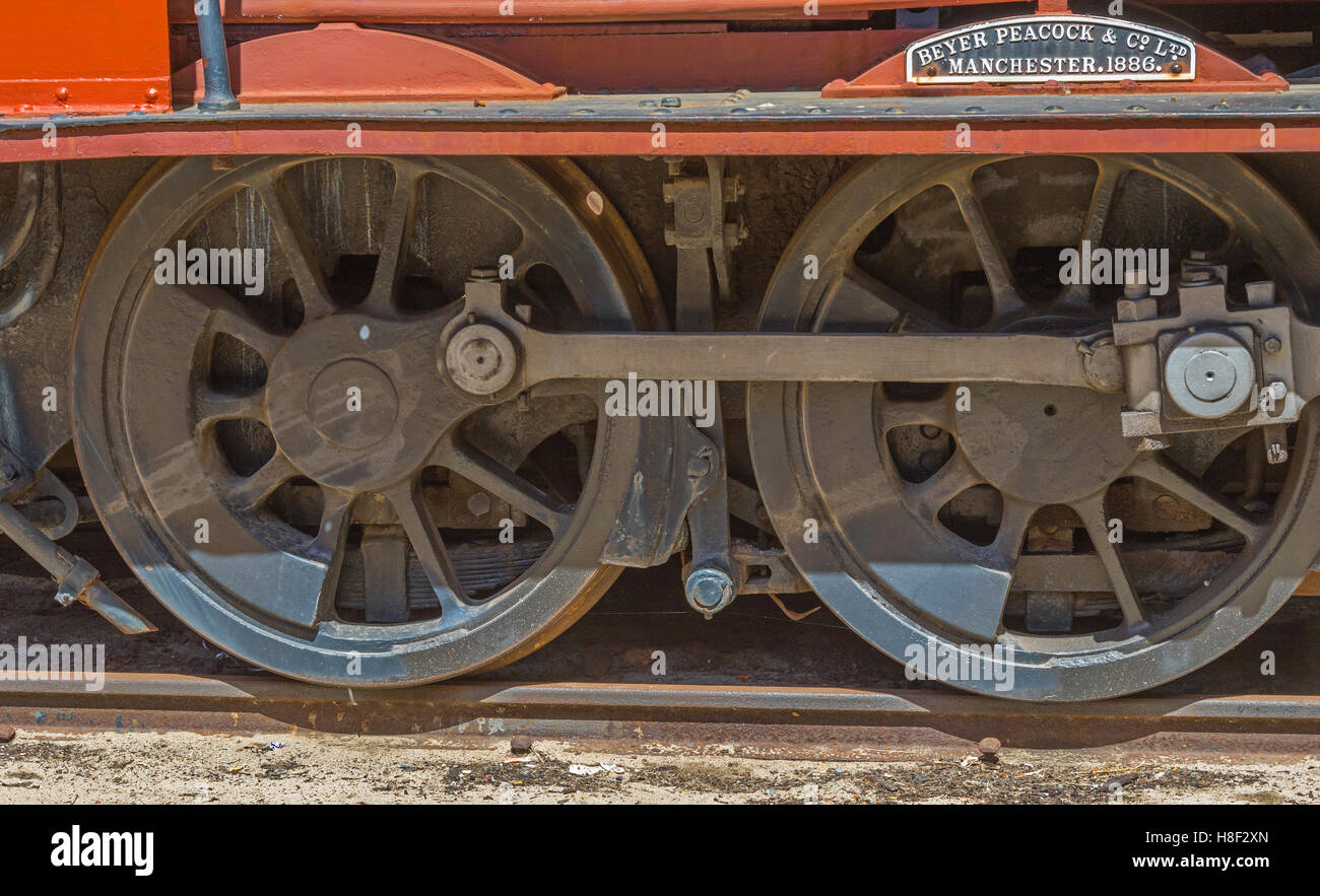 Detail of the wheels of a red steam locomotive built by Beyer Peacock & Co of Manchester in 1886. - Stock Image
