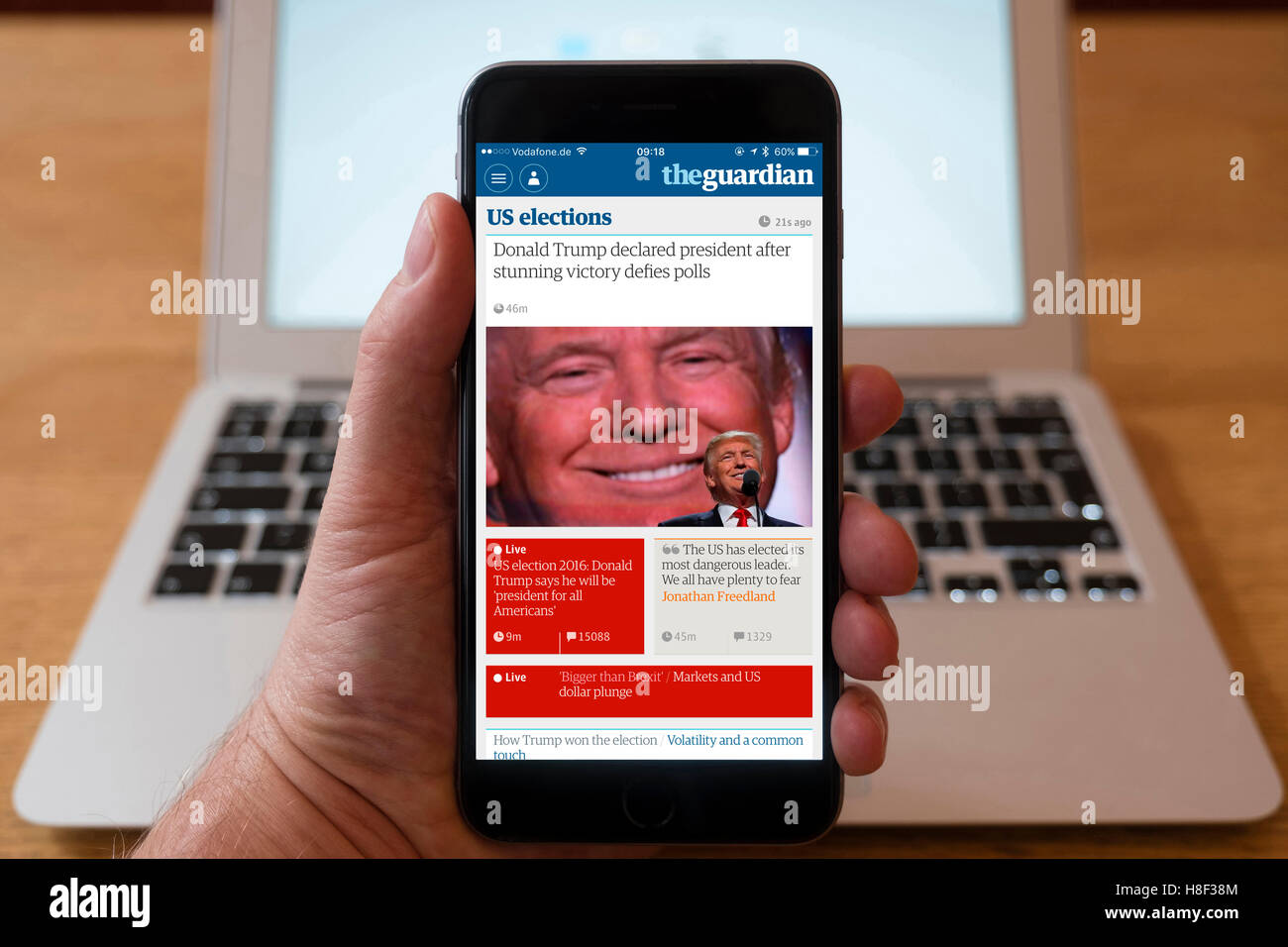 Detail of iPhone smart phone showing online mobile  newspaper front-page headline from The Guardian following Donald - Stock Image