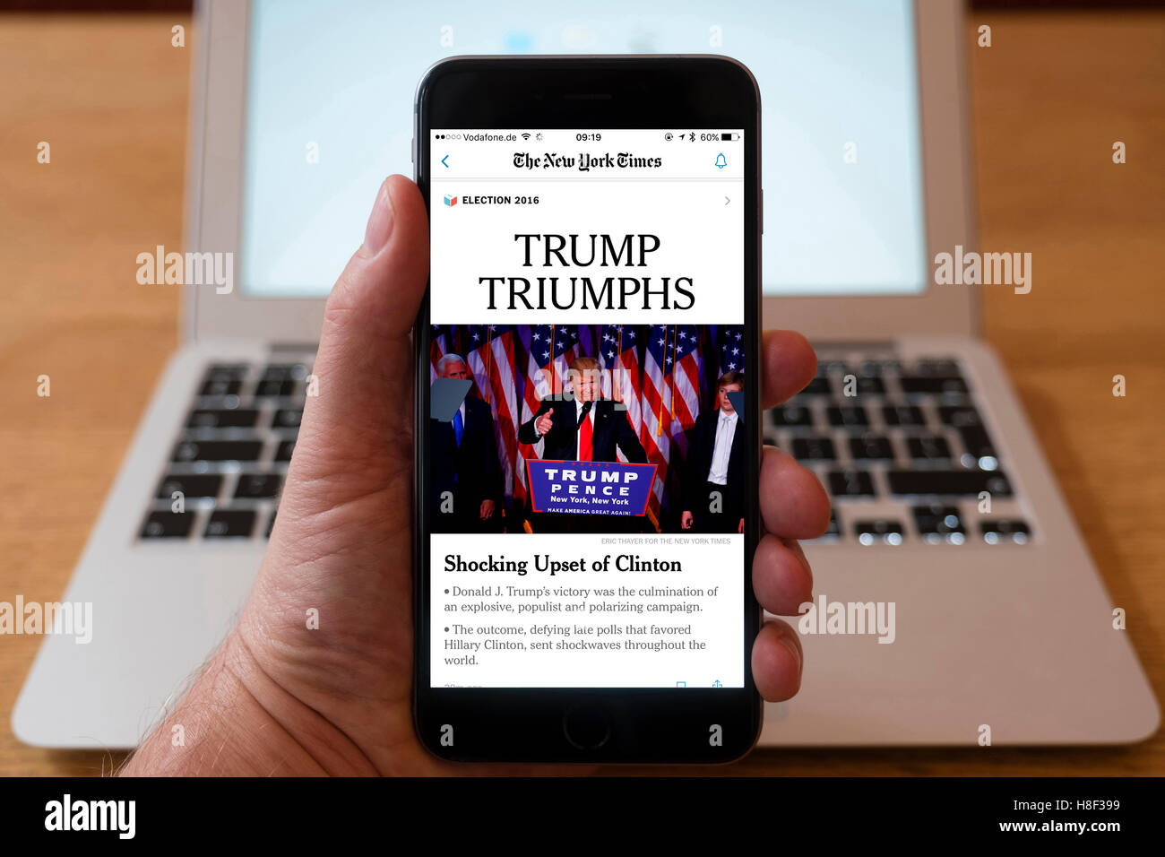 Detail of iPhone smart phone showing online mobile  newspaper front-page headline from The New York Times  following - Stock Image