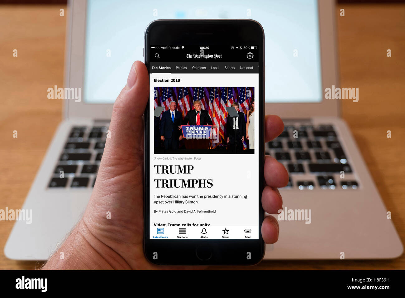 Detail of iPhone smart phone showing online mobile  newspaper front-page headline from The Washington Post following - Stock Image